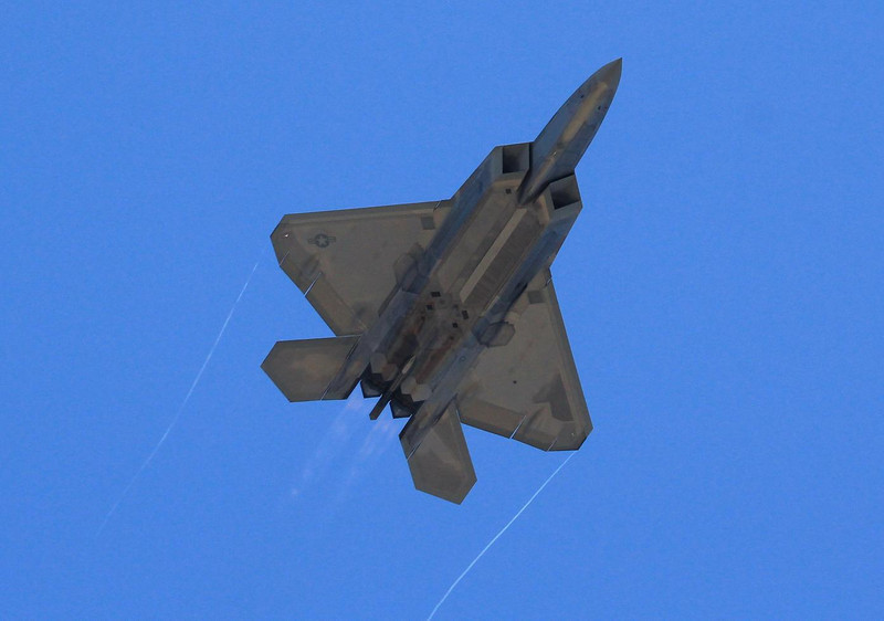 Underside view of an F-22 Raptor shows its beautiful proportions. Notice the absence of right angles to the flight path- a key to steath design, but just the beginning of what it takes to strike a small radar signature.