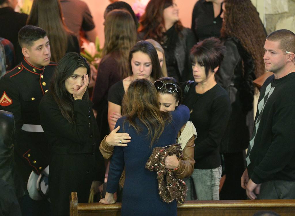 . Funeral services were held for Torrance High student Valentina d\'Alessandro Wednesday, December 11, 2013, in Torrance, CA. Family and friends gather around Valentina\'s mother Lili after the ceremony. D\'Alessandro was killed in a traffic collision in Wilmington Saturday. Photo by Steve McCrank/DailyBreeze