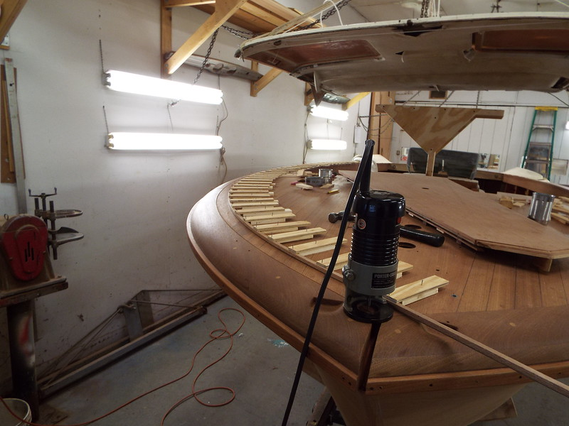 Starboard outside deck seam routed with he use of a jig to hold the shape.