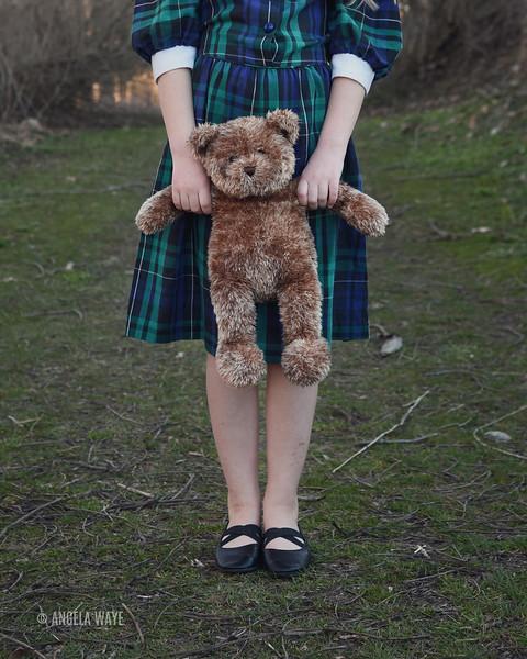 Lonely School Child Holding Teddy Bear