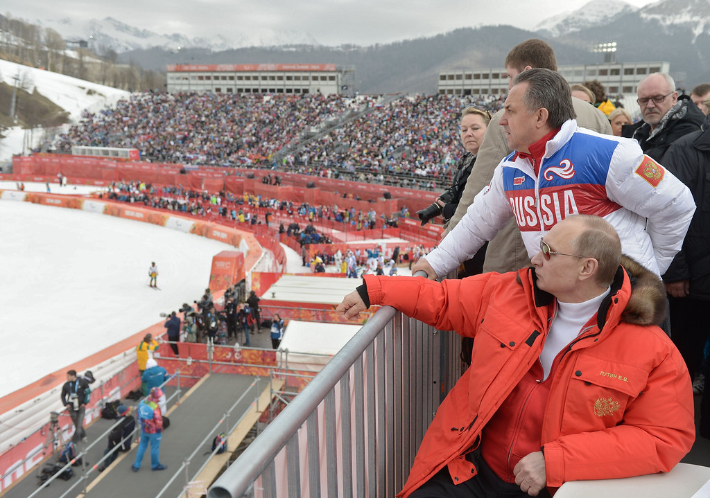 . Russian President Vladimir Putin (foreground) watches a men\'s Alpine skiing event at the Rosa Khutor centre at the Sochi 2014 Winter Paralympics on March 9, 2014.  ALEXEY NIKOLSKY/AFP/Getty Images