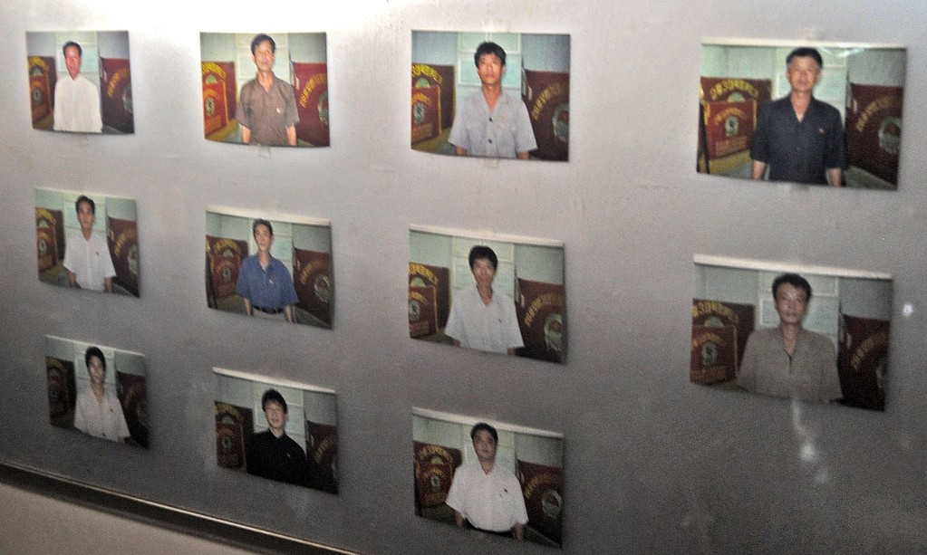 . Portraits of crew members are seen on a wall of North Korean vessel Chong Chong Gang at Manzanillo harbour in Colon, 90 km from Panama City on July 16, 2013.   AFP PHOTO / Rodrigo ARANGUA/AFP/Getty Images