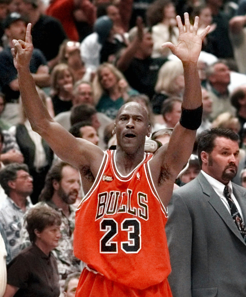 Description of . Chicago Bulls guard Michael Jordan holds up six fingers for the six NBA Championships the Bulls have won after Chicago defeated 87-86 in Salt Lake City, in this June 14, 1998. If Michael Jordan returns to the NBA, there's a 99.9 percent chance that every young whippersnapper in the league will be looking to knock a little of the tarnish off his legend.  At 38, he would be a marked man among a new generation of players who were toddlers back when Jordan was pushing Magic Johnson and Larry Bird aside.(AP Photo/Mark J. Terrill)
