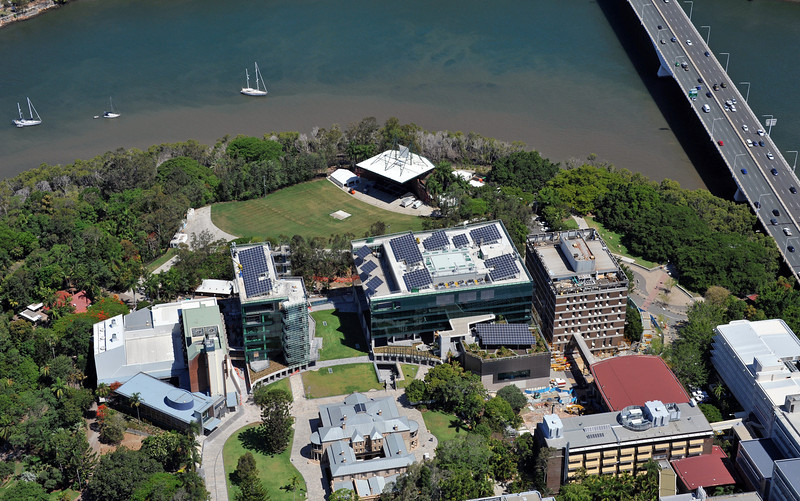 Photo of QUT L block, before structural demolition commences, showing the riverstage in the background.