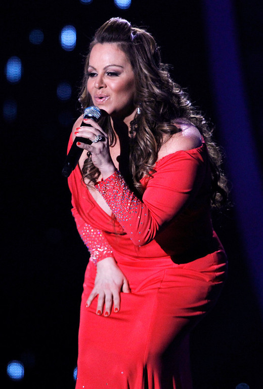 . In this April 26, 2012, file photo, singing superstar Jenni Rivera performs during the Latin Billboard Awards in Coral Gables, Fla. Authorities in Mexico say the wreckage of a small plane believed to be carrying Rivera has been found on Sunday, Dec. 9, 2012, and there are no apparent survivors. (AP Photo/Lynne Sladky, file)