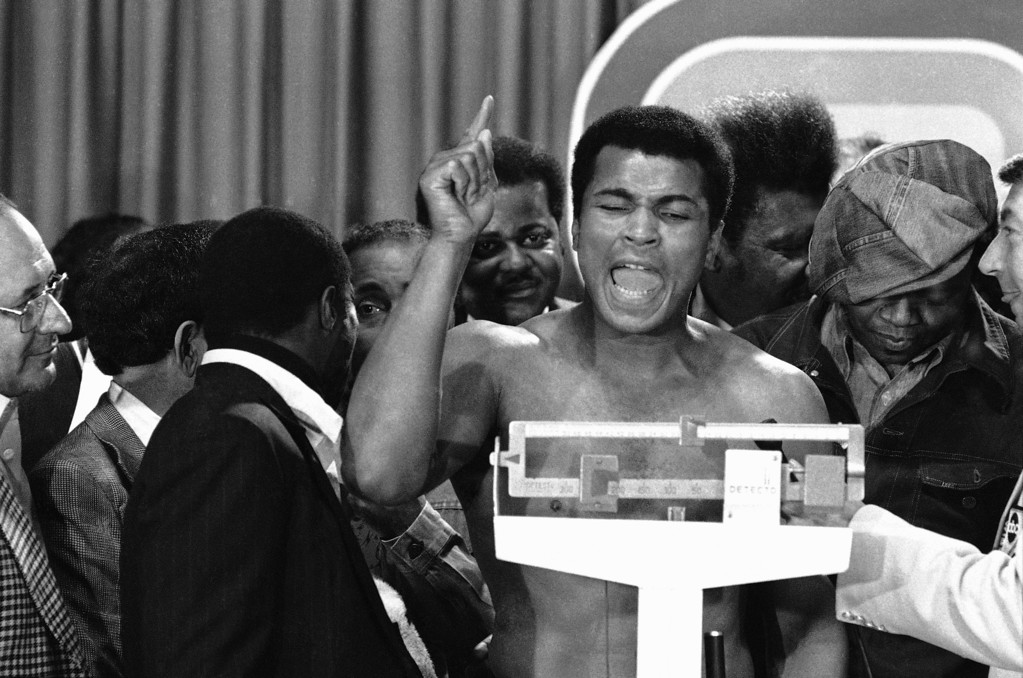 . Heavyweight champion Muhammad Ali expresses himself during weight-in at Cleveland Coliseum in Richfield, Ohio, March 23, 1975. Chuck Wepner will challenge Ali for the title in a scheduled 15-round bout on Monday at night. (AP Photo)