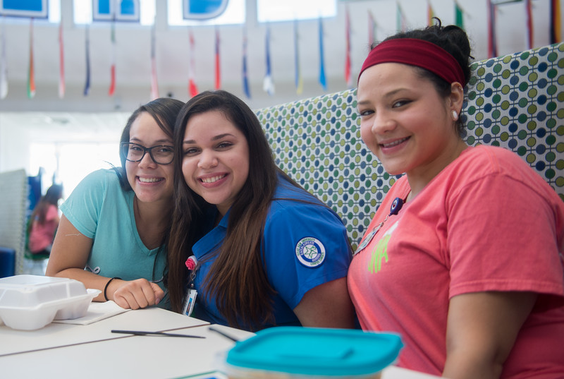 Gabriela Kober (left), Gabby Coronada, and Jeanette Guerra enjoy their lunch in University Center.