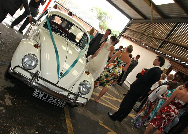 A vw beetle taking a bride and groom for a ride from Dairy Barns to Sea Palling beach