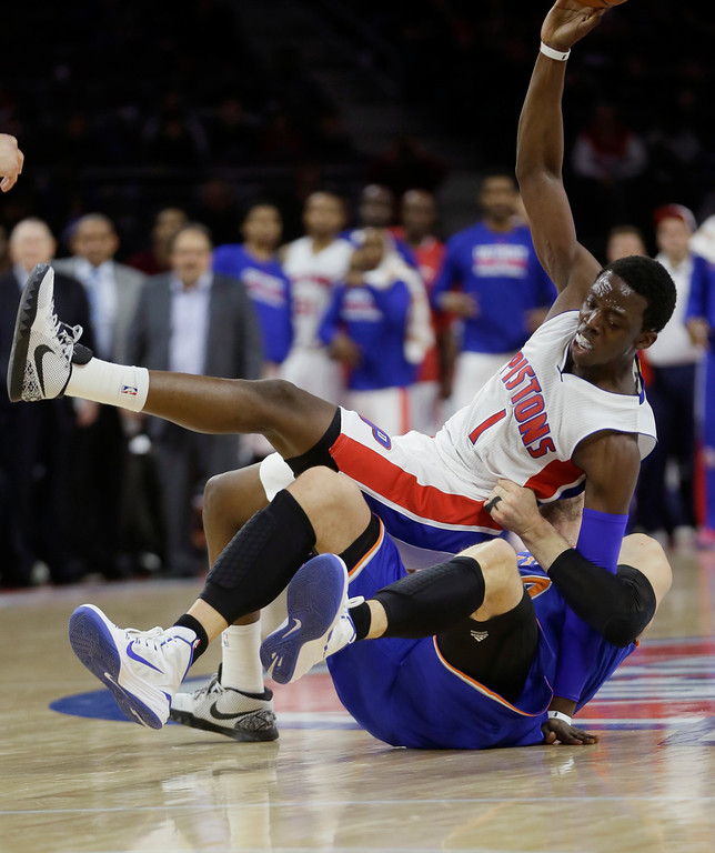. Detroit Pistons guard Reggie Jackson (1) is pulled down by New York Knicks center Andrea Bargnani during the second half of an NBA basketball game, Friday, Feb. 27, 2015 in Auburn Hills, Mich. (AP Photo/Carlos Osorio)