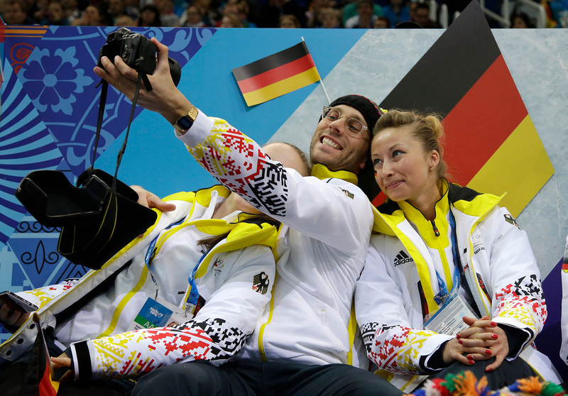 . German team members take a photograph of themselves during the team pairs short program figure skating competition at the Iceberg Skating Palace during the 2014 Winter Olympics, Thursday, Feb. 6, 2014, in Sochi, Russia. (AP Photo/Darron Cummings, Pool)