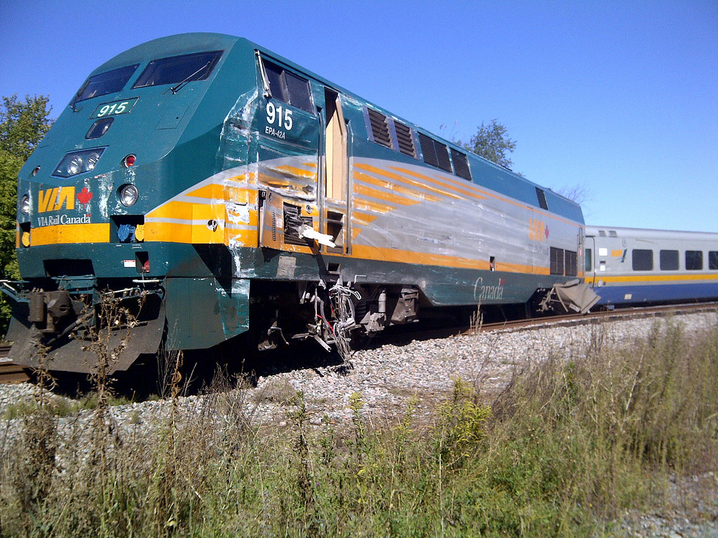 """. This handout image provided September 18, 2013 by the Transportation Safety Board of Canada, shows the front of a VIA Rail passenger train after it collided witrh a double-decker bus at a crossing in a suburb of Canada\'s capital Ottawa, killing at least five people. Ottawa fire department spokesman Marc Messier told broadcaster CTV that at least five bus passengers died and up to six others were injured. The Via Rail company operating the affected train on the Ottawa to Toronto line -- on which traffic has been suspended -- reported no fatalities. The OC Transpo bus was on its way downtown during the morning rush hour when the accident happened, according to local media reports.  AFP PHOTO/HNADOUT / TSB CANADA    == RESTRICTED TO EDITORIAL USE / MANDATORY CREDIT: \""""AFP PHOTO / TSB CANADA / NO SALES / NO MARKETING / NO ADVERTISING CAMPAIGNS / DISTRIBUTED AS A SERVICE TO CLIENTS ==HO/AFP/Getty Images"""