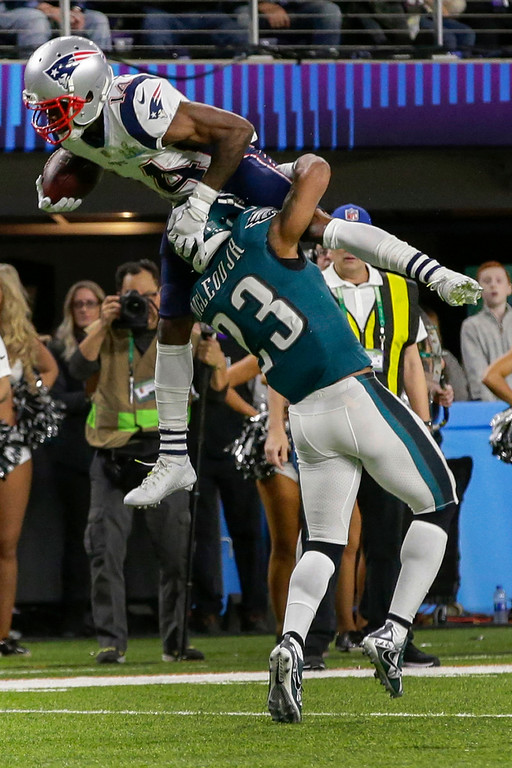 . New England Patriots wide receiver Brandin Cooks (14), leaps over Philadelphia Eagles free safety Rodney McLeod (23), during the first half of the NFL Super Bowl 52 football game, Sunday, Feb. 4, 2018, in Minneapolis. (AP Photo/Frank Franklin II)