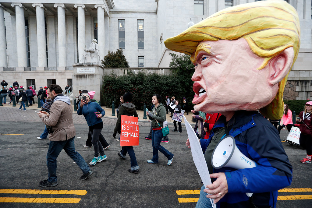 . Protesters walk on Independence Avenue during the Women\'s March on Washington, Saturday, Jan. 21, 2017 in Washington. (AP Photo/Alex Brandon)