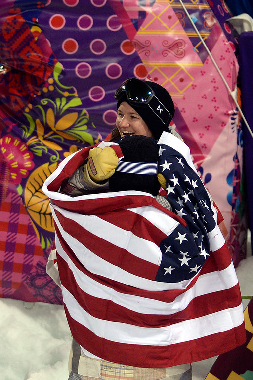 . American gold medalist Kaitlyn Farrington (back facing) hugs bronze medalist American Kelly Clark after a women\'s snowboard halfpipe final at the Rosa Khutor Extreme Park. Sochi 2014 Winter Olympics on Wednesday, February 12, 2014. (Photo by AAron Ontiveroz/The Denver Post)