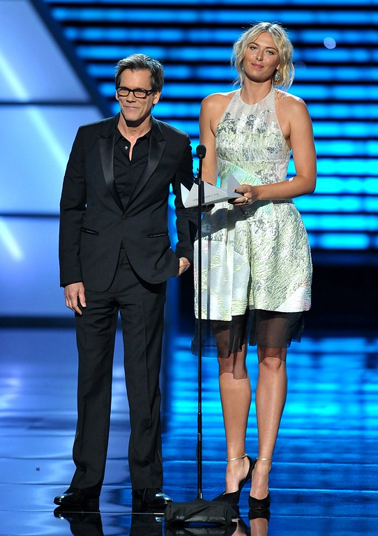 . Kevin Bacon, left, and Maria Sharapova present an award at the ESPY Awards on Wednesday, July 17, 2013, at the Nokia Theater in Los Angeles. (Photo by John Shearer/Invision/AP)