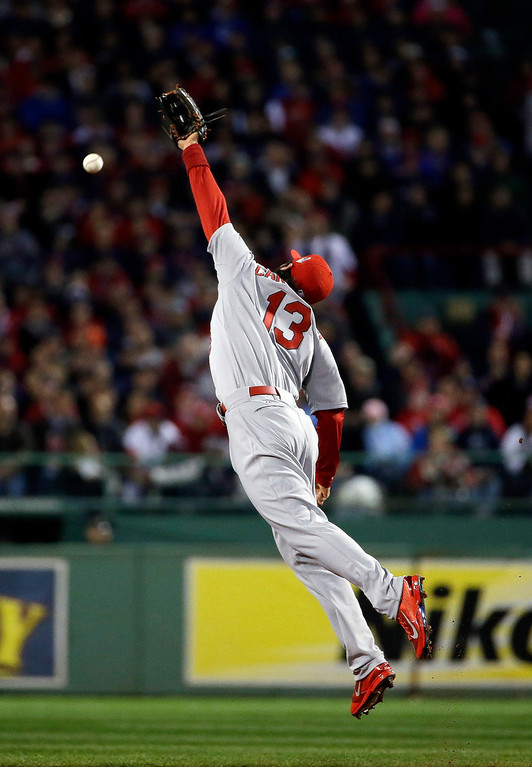 . St. Louis Cardinals\' Matt Carpenter cannot make a play on ball hit by  Boston Red Sox\'s David Ross during the second inning of Game 1 of baseball\'s World Series Wednesday, Oct. 23, 2013, in Boston. (AP Photo/Matt Slocum)