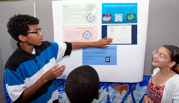 08/16/19 Wesley Bunnell | Staff TRIO, a two week long summer program run by CCSU in science and arts held their closing ceremony on Friday August 16, 2019 at Founders Hall at CCSU. Julian Rodriguez, L, a rising 8th grader at HALS Academy, explains his project to fellow students including Jazmarie Santiago, R, a rising 8th grade student at Pulaski Middle School.