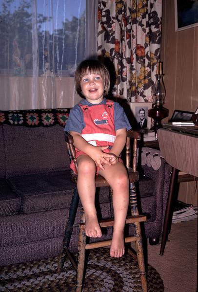 Michael Hopkins in Great Grandpa Elmer Hopkins' high chair at 8C Cortez Court, Casa Mobile Park, Fairfield, California on 5 July 1974.
