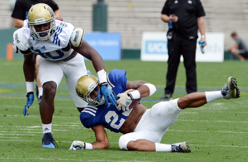 . UCLA Bruins running back Roosevelt Davis (22) during a NCAA college spring football game at the Rose Bowl in Pasadena, Calif., Saturday, April 25, 2015.