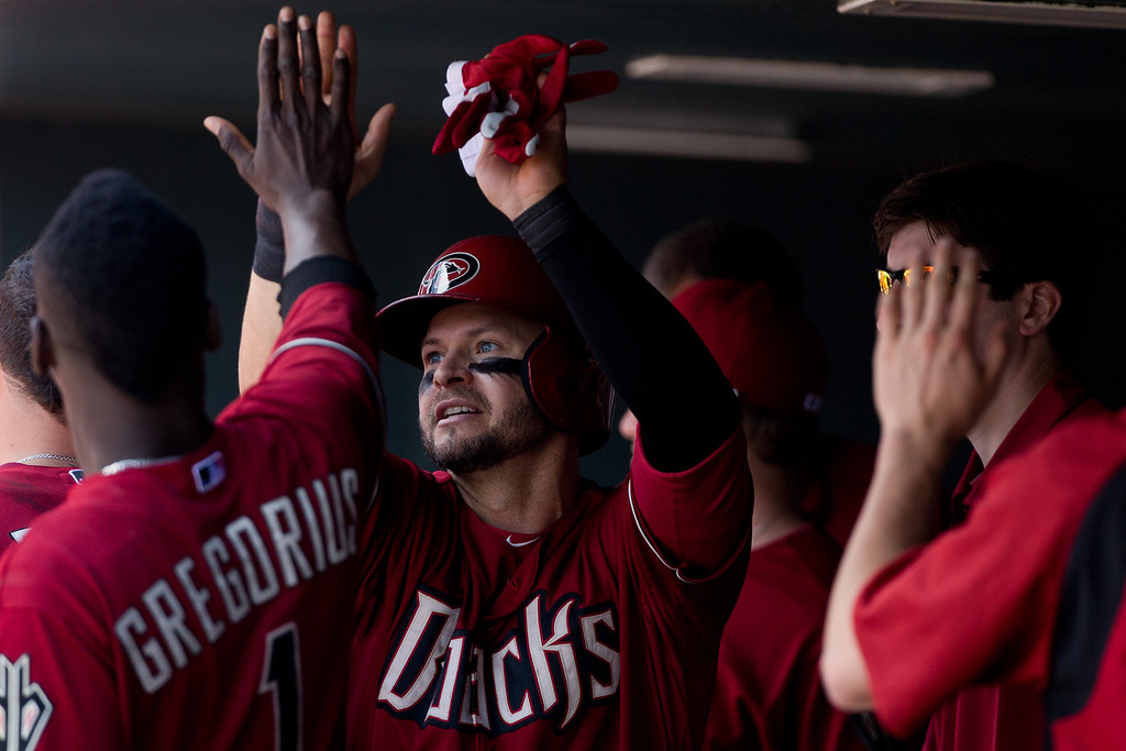 . Cody Ross #7 of the Arizona Diamondbacks celebrates in the dugout after scoring during the fourth inning against the Colorado Rockies at Coors Field on May 22, 2013 in Denver, Colorado. The Rockies defeated the Diamondbacks 4-1.  (Photo by Justin Edmonds/Getty Images)