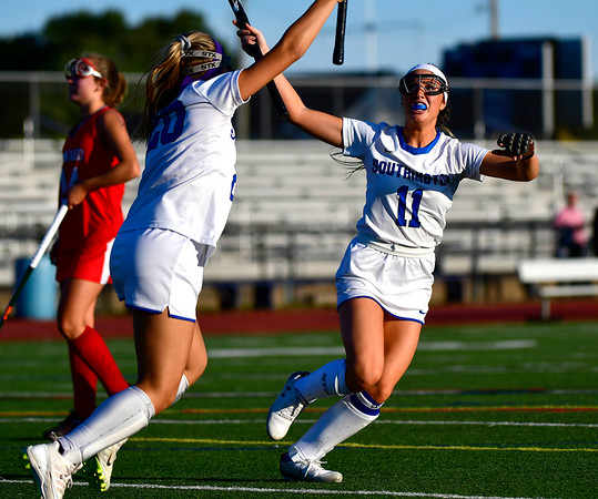 10/15/2019 Mike Orazzi | StaffrSouthington High Schools Maggie Ritchie (20) and Jenna Sheehan (11) during a 2-2 tie with Conard High School in Southington on Tuesday afternoon. r