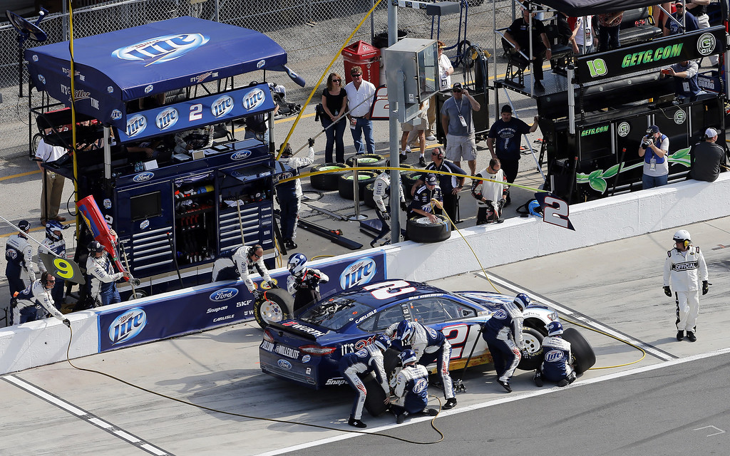 . Brad Keselowski, driver of the #2 Miller Lite Ford, pits during the NASCAR Sprint Cup Series Budweiser Duel 1 at Daytona International Speedway on February 21, 2013 in Daytona Beach, Florida.  (Photo by Sam Greenwood/Getty Images)