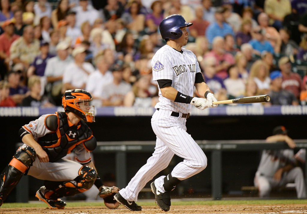 . DENVER, CO. - June 28: Tyler Colvin of Colorado Rockies (21) singles from Barry Zito of San Francisco Giants (75) in the 2nd inning of the game at Coors Field. Denver, Colorado. June 28, 2013. (Photo By Hyoung Chang/The Denver Post)
