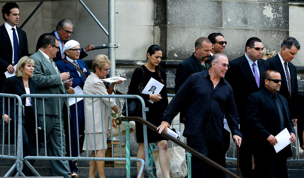 ". Joe Pantoliano, fifth from left, in white hat, a cast member of ""The Sopranos\"", walks out with a crowd of Cathedral Church of Saint John the Divine after funeral services actor James Gandolfini, Thursday, June 27, 2013, in New York. (AP Photo/Julio Cortez)"