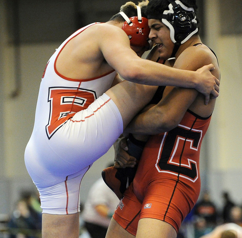 . Joel Hernandez of Brighton, left, and Jareb Aziz of Centauri are in the 182 pound final of Northern Colorado Christmas Tournament at Island Grove Event Center in Greeley, Colo., on Saturday, Dec. 22, 2012. Aziz won the match. Hyoung Chang, The Denver Post