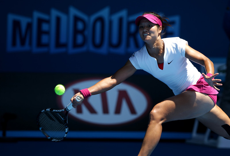 . Li Na of China makes a forehand return to Eugenie Bouchard of Canada during their semifinal at the Australian Open tennis championship in Melbourne, Australia, Thursday, Jan. 23, 2014.(AP Photo/Aaron Favila)