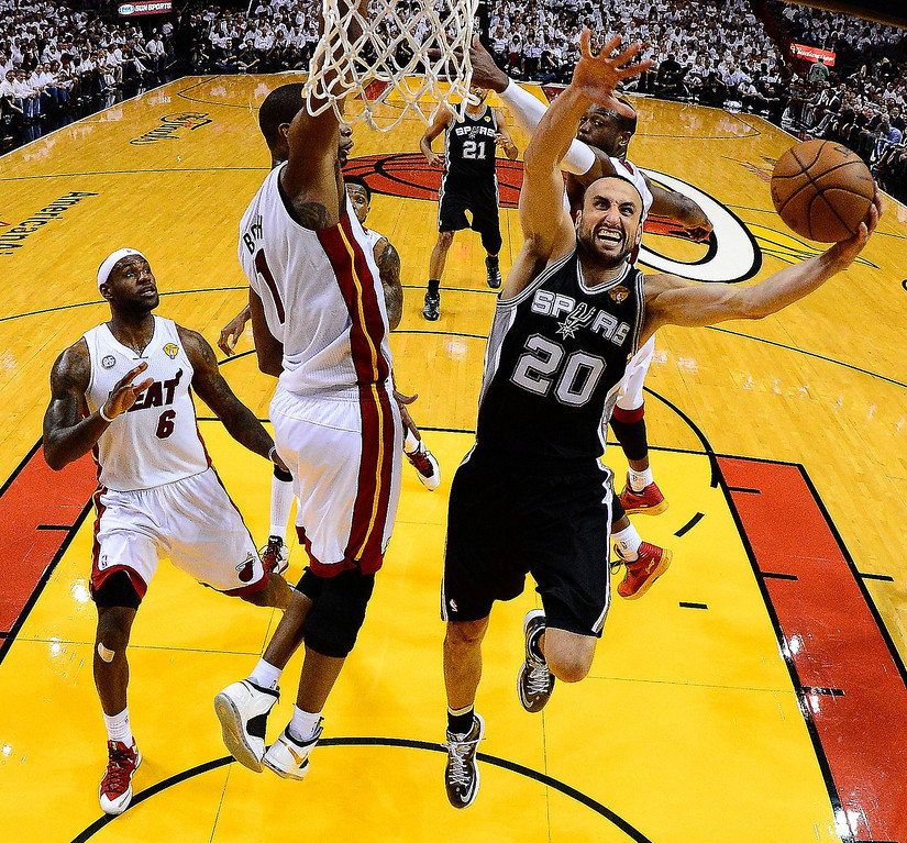 . San Antonio Spurs shooting guard Manu Ginobili (20) shoots against Miami Heat center Chris Bosh (1)during the first half of Game 2 in the NBA Finals basketball game, Sunday, June 9, 2013 in Miami. The Miami Heat won 103-84. (AP Photo/Larry W. Smith, Pool)