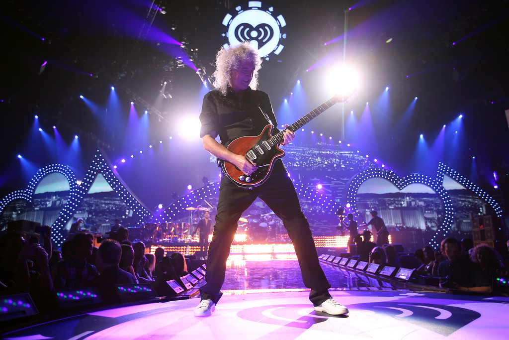 . Brian May of Queen performs onstage during the iHeartRadio Music Festival at the MGM Grand Garden Arena on September 20, 2013 in Las Vegas, Nevada.  (Photo by Christopher Polk/Getty Images for Clear Channel)