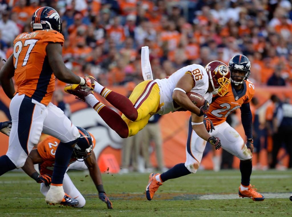 . Washington Redskins tight end Jordan Reed (86) dives over the Denver Broncos defense during the fourth quarter.  (Photo by Tim Rasmussen/The Denver Post)