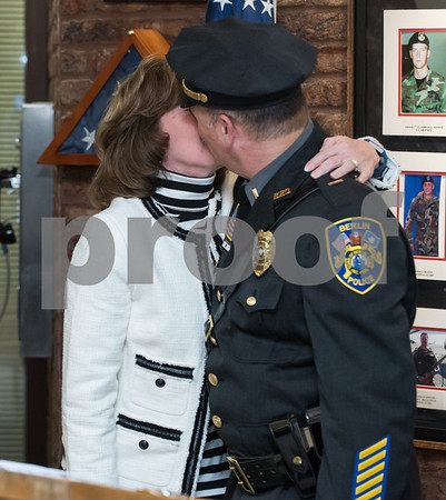 01/17/18 Wesley Bunnell | Staff The Berlin Police Department held a promotion ceremony for two officers on Wednesday evening at town hall. Eileen Gallupe kisses her husband Lieutenant Drew Gallupe after pinning on his new badge.