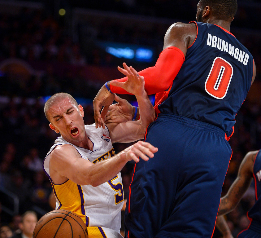 . Lakers� Steve Blake looses the ball as Detroit�s Andre Drummond defends on the play during first half action at Staples Center Sunday, November 17, 2013.  ( Photo by David Crane/Los Angeles Daily News )