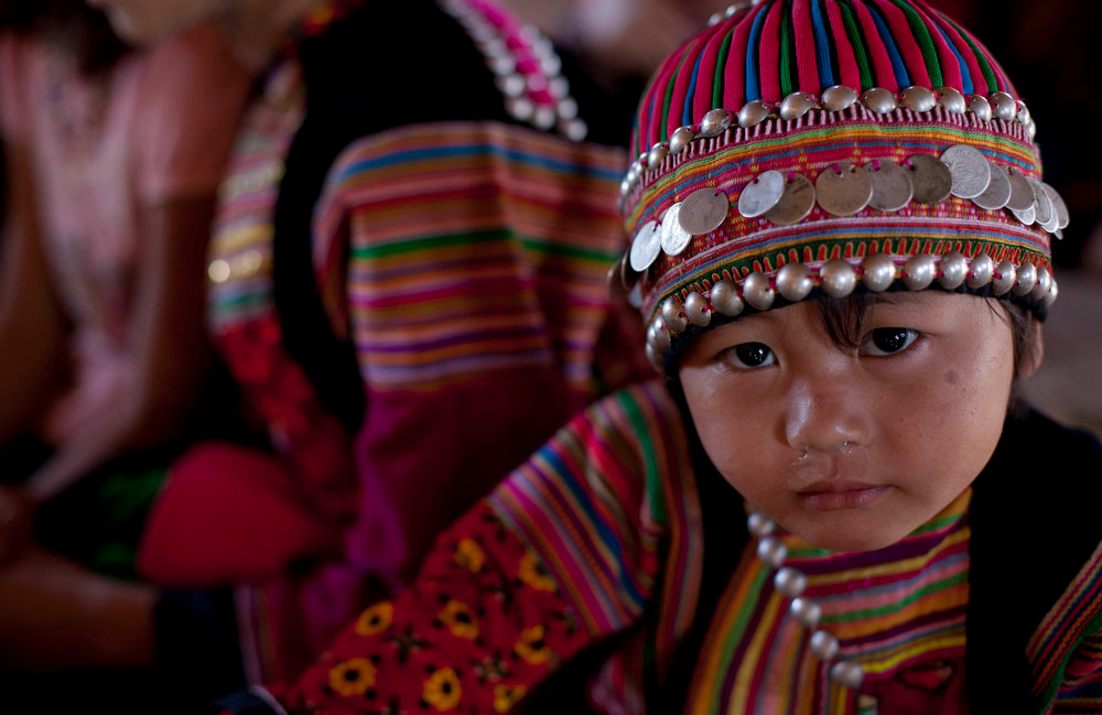 . An ethnic Lisu child dressed in traditional clothing attends school in Ywar Thar Yar village, central Shan state, Myanmar on Feb 21, 2013. Far from Myanmar\'s postcard-perfect pagodas and colonial relics, the remote mountain villages of southern Shan State do not appear on maps of Myanmar or in any guide books. In obscurity, they have been ground zero for Myanmar\'s drug trade which has thrived on poverty and corruption. (AP Photo/Gemunu Amarasinghe)