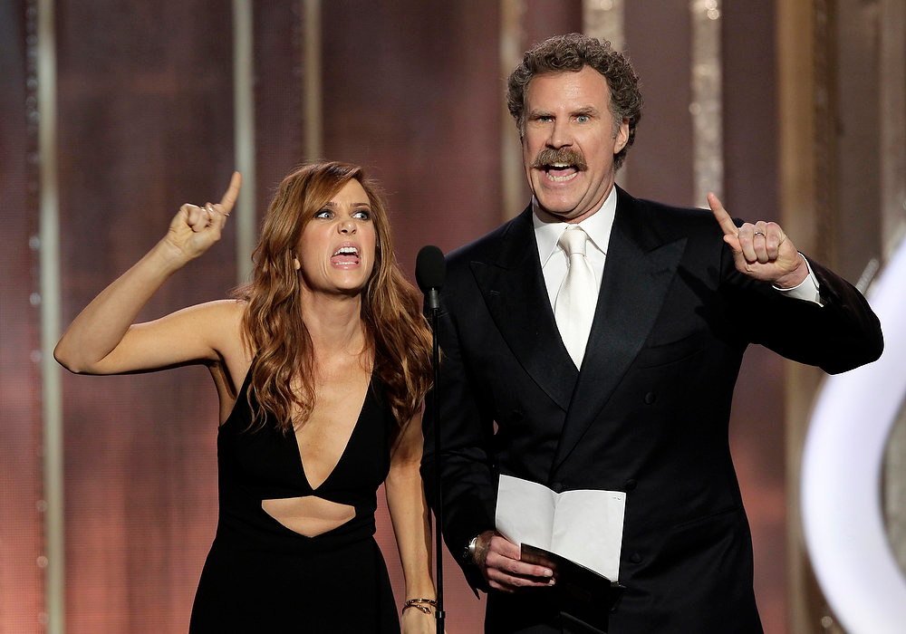 Description of . This image released by NBC shows presenters  Kristen Wiig, left, and Will Ferrell appear on stage during the 70th Annual Golden Globe Awards at the Beverly Hilton Hotel on Jan. 13, 2013, in Beverly Hills, Calif. (AP Photo/NBC, Paul Drinkwater)