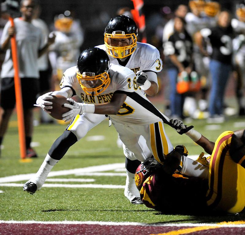 . LOS ANGELES - 10/04/2013 - (Mark Savage) San Pedro player Antonio Frazier scores a touchdown in the 1st quarter. Fairfax High School plays San Pedro High School at Fairfax High School.