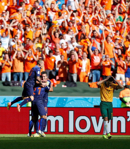 . Netherlands\' Robin van Persie (9) is congratulated by his teammates after scoring his side\'s second goal during the group B World Cup soccer match between Australia and the Netherlands at the Estadio Beira-Rio in Porto Alegre, Brazil, Wednesday, June 18, 2014. (AP Photo/Jon Super)