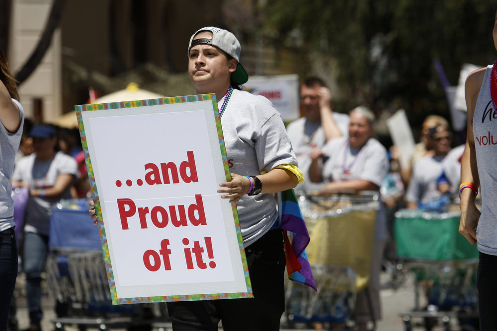 . People from the VONS grocery store chain march in the 43rd L.A. Pride Parade on June 9, 2013 in West Hollywood, California. More than 400,000 people are expected to attend the parade in support of lesbian, gay, bisexual and transgender communities.  (Photo by David McNew/Getty Images)