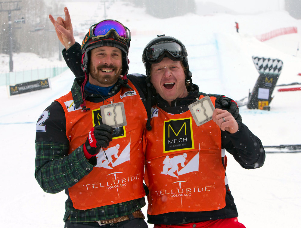 . In this photo provided by Nathan Bilow Photography, United States\' Seth Wescott, left, and Nate Holland hold their first-place awards for the snowboard cross team World Cup event in Telluride, Colo., Saturday, Dec. 15, 2012. (AP Photo/Nathan Bilow)