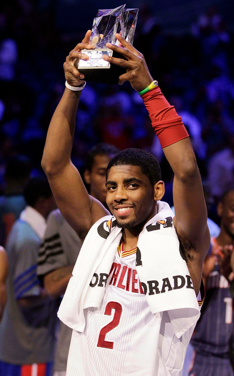 . Cleveland Cavaliers\' Kyrie Irving, of Team Chuck, hold the MVP trophy following the NBA All-Star Rising Stars Challenge game in Orlando, Fla. Friday, Feb. 24, 2012. Team Chuck defeated Team Shaq 146-133. (AP Photo/Chris O\'Meara)