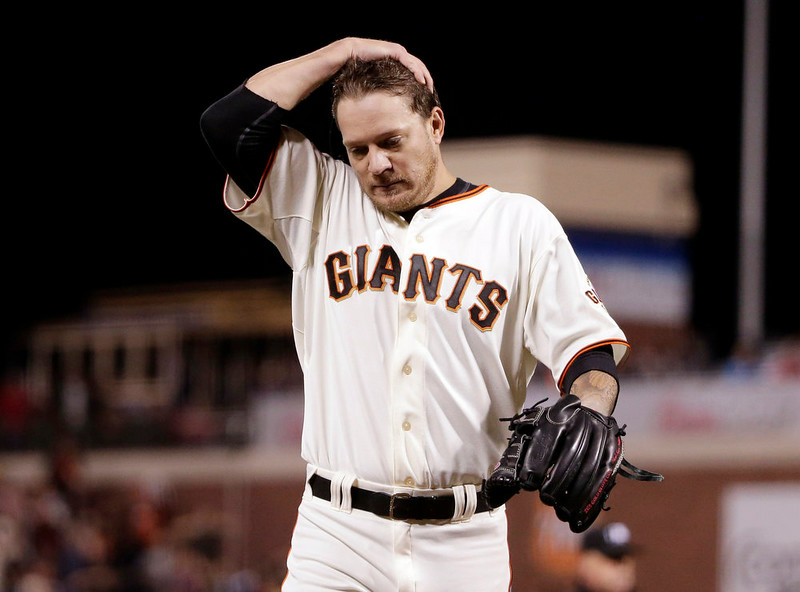 . San Francisco Giants starting pitcher Jake Peavy reacts after Colorado Rockies\' D.J. LeMahieu was called safe at the plate on a single by Charlie Blackmon during the seventh inning of a baseball game Monday, Aug. 25, 2014, in San Francisco. LeMahiue was called out after a replay review. (AP Photo/Marcio Jose Sanchez)