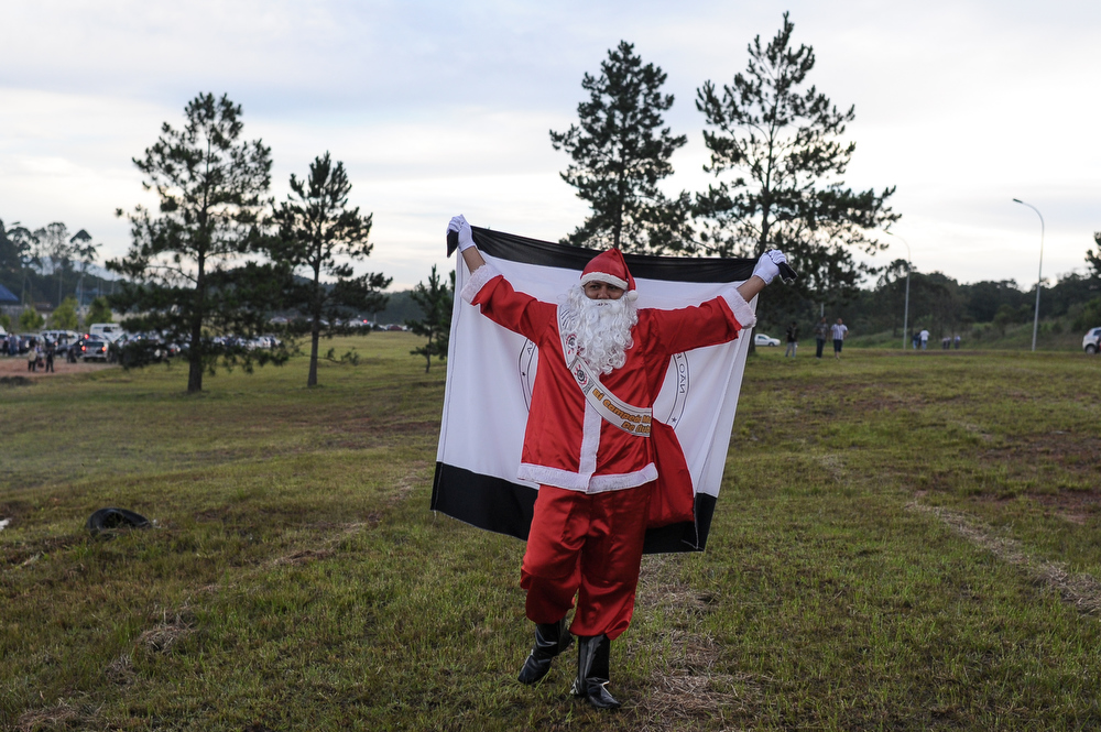 Description of . A fan of Corinthians disguised as Santa Claus waits for the team arrival at Guarulhos airport, in surburb of Sao Paulo, Brazil, on December 18, 2012. Copa Libertadores Champion Corinthians beat UEFA Champion Chelsea FC on December 16, in Yokohama, Japan.    YASUYOSHI CHIBA/AFP/Getty Images