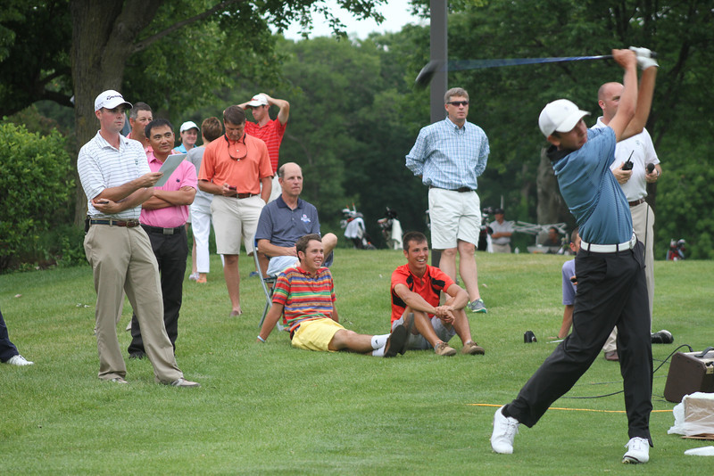 Players and parents watch the Long Drive Contest on Monday night.