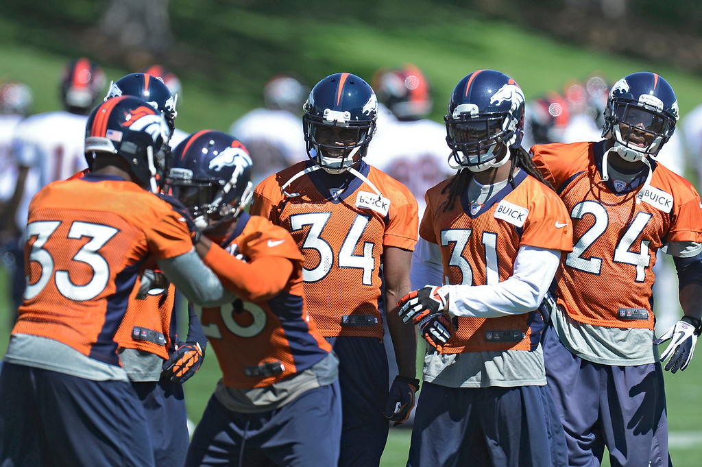 . Denver Broncos Quentin Jammer (34) Omar Bolden (31) and Cahmp Bailey (24) watch Duke Ihenacho (33) and Rahim Moore (26) run through drills during OTA\'s May 30, 2013 at Dove Valley. (Photo By John Leyba/The Denver Post)