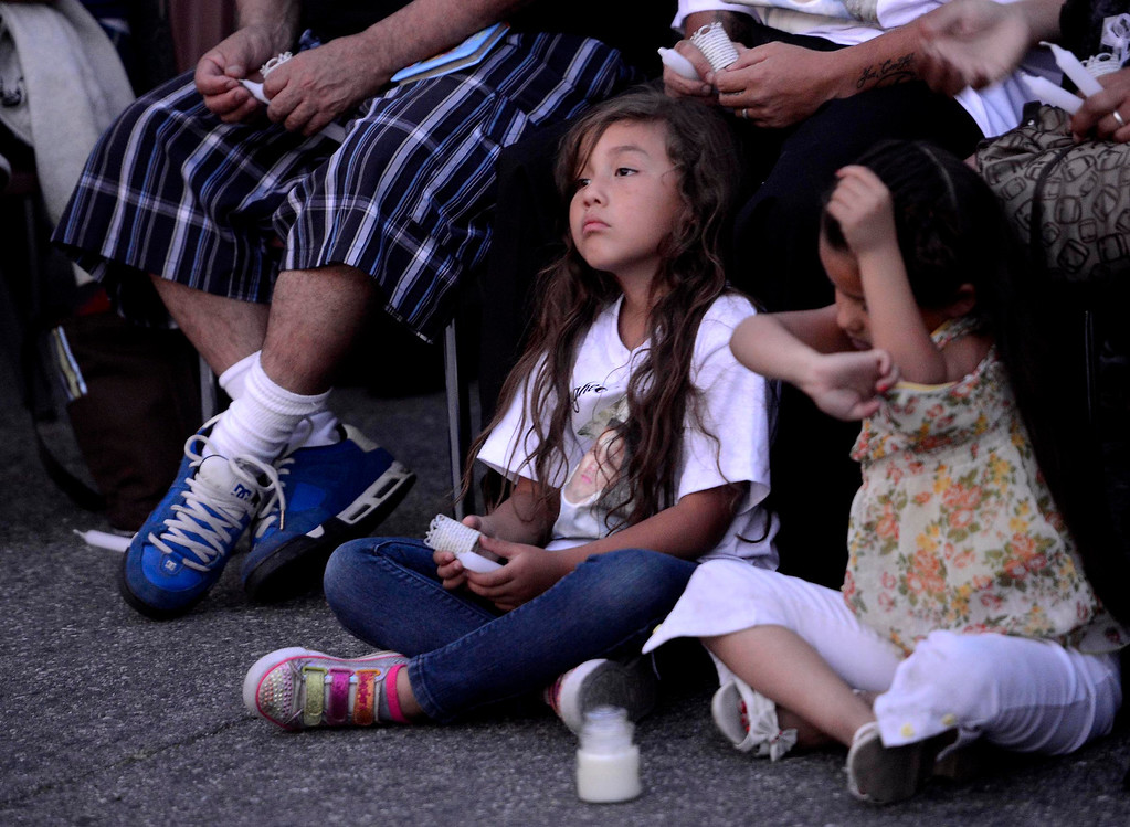 . A scene from the annual Victims Candlelight Vigil at the police station in San Bernardino April 23, 2013.   GABRIEL LUIS ACOSTA/STAFF PHOTOGRAPHER.