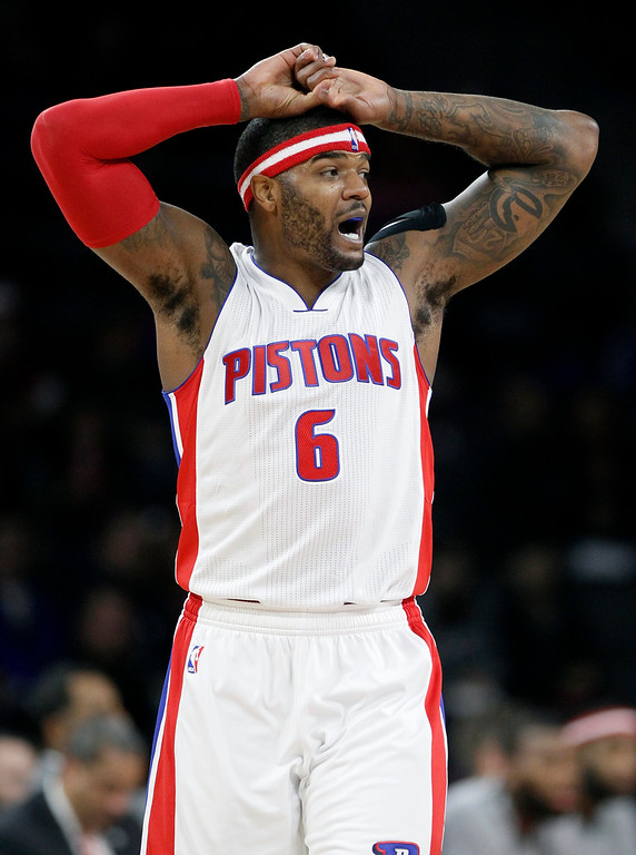 . Detroit Pistons\' Josh Smith (6) reacts after being whistled for a foul during the first half of an NBA basketball game against the Milwaukee Bucks, Friday, Nov. 7, 2014, in Auburn Hills, Mich. (AP Photo/Duane Burleson)