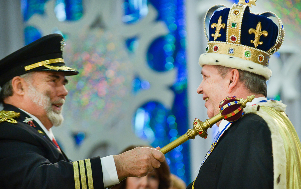 . Making it official with a tap of the scepter, Greg Pluff, right, was crowned King Winter the 56th by last year\'s King Winter David Forsell during the Senior Royalty Coronation. (Pioneer Press: Ben Garvin)