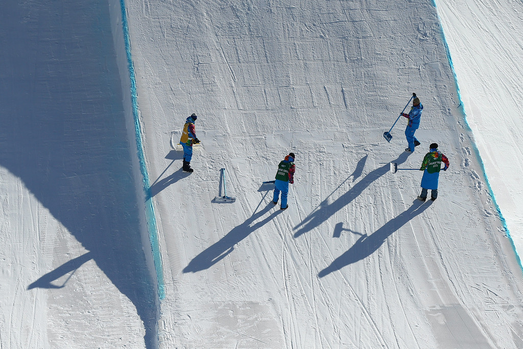. Olympic workers work on the course during Snowboard Slopestyle practice at the Extreme Park at Rosa Khutor Mountain ahead of the Sochi 2014 Winter Olympics on February 4, 2014 in Sochi, Russia  (Photo by Cameron Spencer/Getty Images)